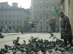 Woman with pigeons in Rome