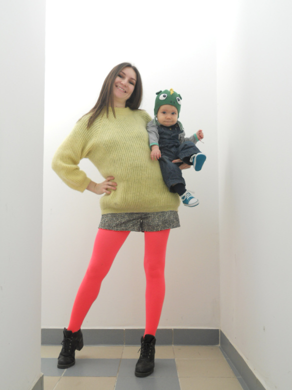 Mother_holding_baby_tights_legs